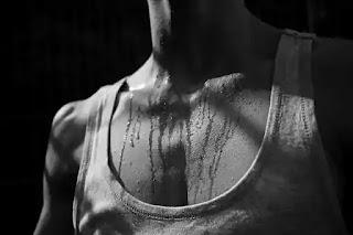 man sweating black and white