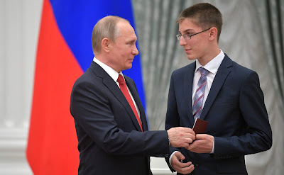 President of the Russian Federation  presents passports to young citizens of Russia.