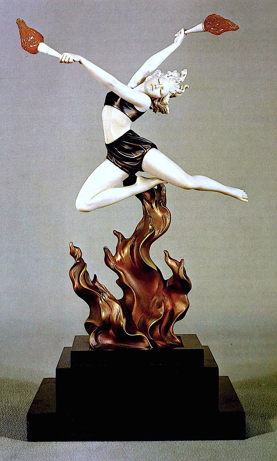 a 1920s Ferdinand Preiss statuette of a woman dancer leaping over fire, a color photograph