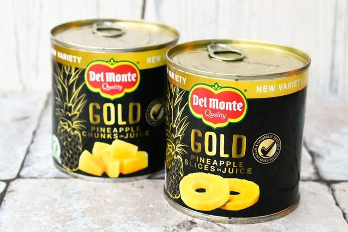 tins of Del Monte Gold Pineapple