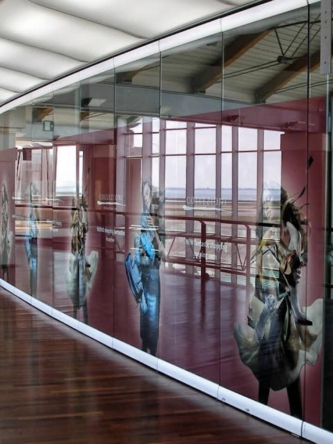 Transparent sliding glass partition