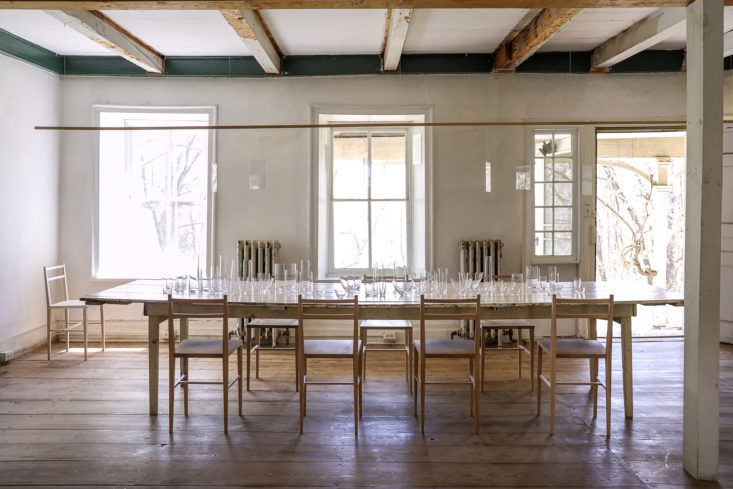 Rustic modern style in a farmhouse dining room with huge farm table and minimal decor - found on Hello Lovely Studio