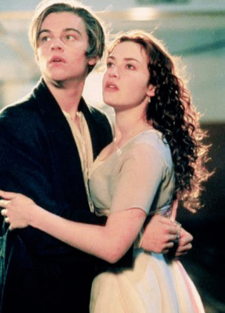 """<img src=""""couple.png"""" alt=""""man and woman from titanic holding each other."""">"""