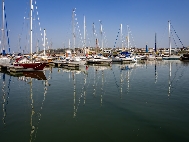 Photo of boats reflected in the still water at Maryport Marina on Monday afternoon