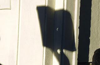 eclpese en la pared