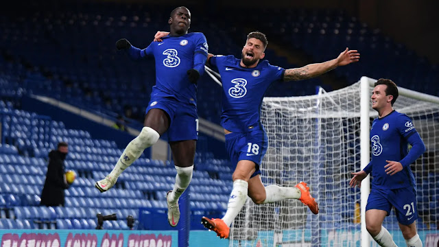 Kurt Zouma and Olivier Giroud celebrating a goal for Chelsea in their win over Leeds