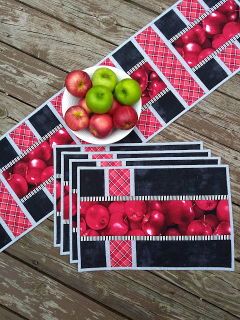 placemats and table runner with apple print, red, grey and black fabric