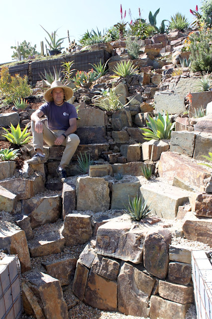 A gardener sitting in his landscape
