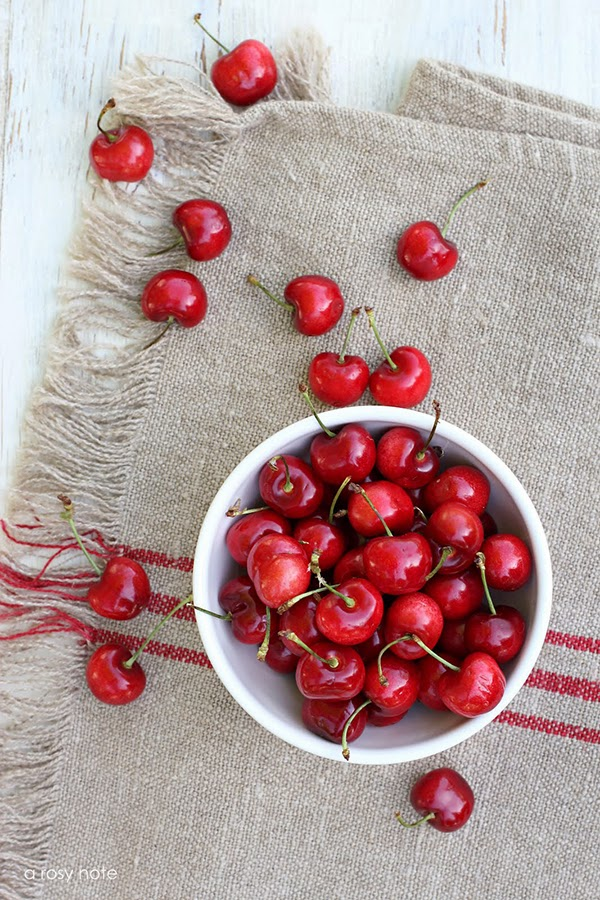 A bowl of cherries on vintage french linen