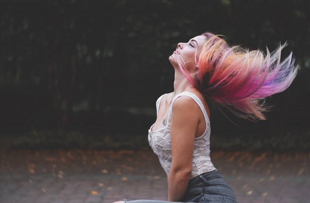 rainbow colored hair flip woman