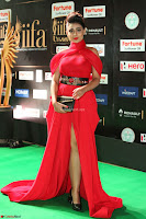Apoorva in a Stunning Tight Leg Split Sleeveless Red Gown at IIFA Utsavam Awards 73.JPG