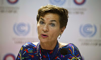 Christiana Figueres was noted at climate talks for her ability to bring warring factions together, with calm, good humour. (Photograph Credit: Ernesto Benavides/AFP/Getty Images) Click to Enlarge.