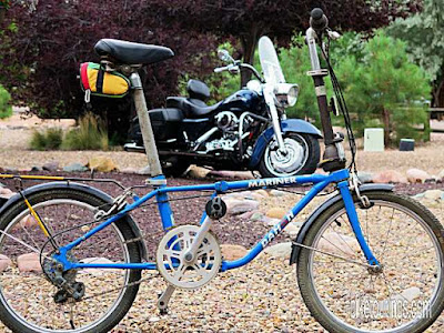 Picture of Dahon Mariner folding bike with Harley Davidson motorcycle in background
