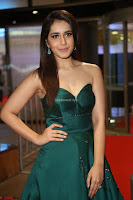 Raashi Khanna in Dark Green Sleeveless Strapless Deep neck Gown at 64th Jio Filmfare Awards South ~  Exclusive 118.JPG