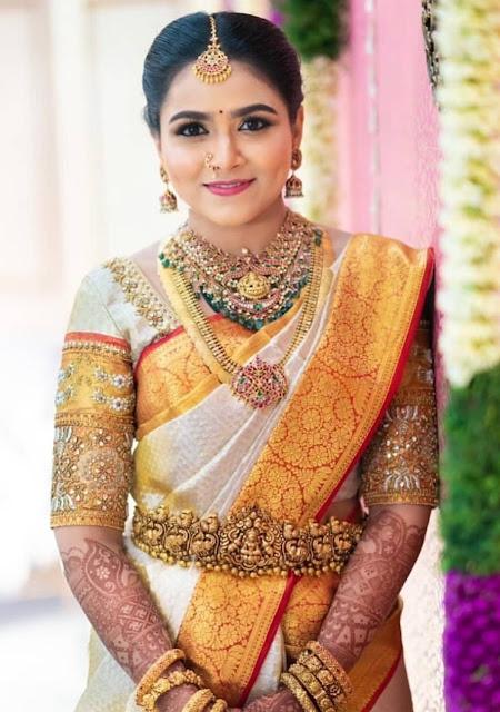 Bride in Peacock Vaddanam Kasu Mala