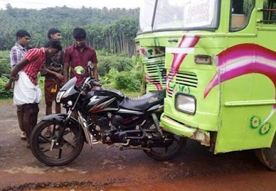 Buss collides with motorcycle