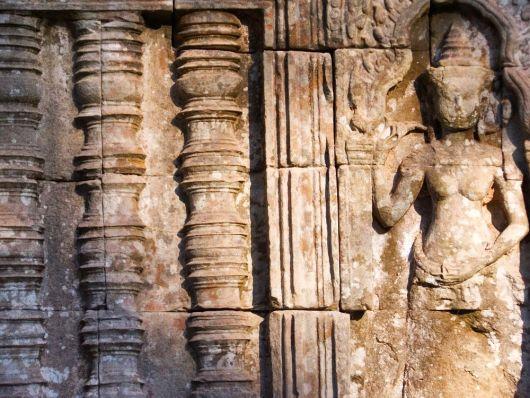Khmer carving on a temple wall at Angkor Wat. Siem Reap, Cambodia
