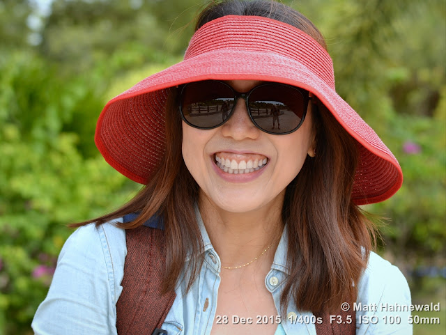Matt Hahnewald Photography; Facing the World; closeup; street portrait; headshot; outdoor; Asia; Southeast Asia; Malaysia; Langkawi; Kuah; smiling; beautiful; Korean girl; sunglasses; sunhat; tourist