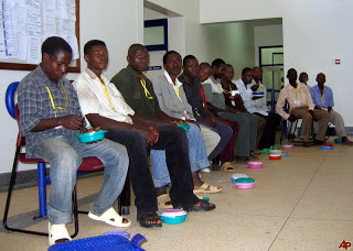 African men wait to learn about circumcision