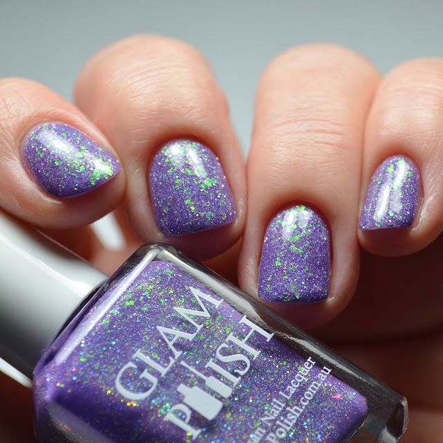 purple nail polish with flakies low light swatch