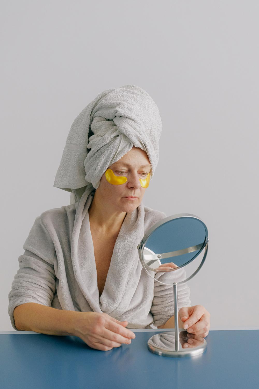 a senior lady doing skincare routine