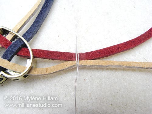 Wrap the wire around two laces to bind them together.