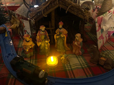Baby Jesus amongst the Three Wise Men and Virgin Mary