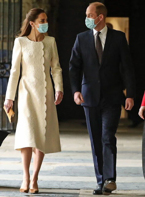Kate Middleton wore a new lace embellishment wool coat from Catherine Walker. Annoushka pearl and Kiki diamond hoop earrings