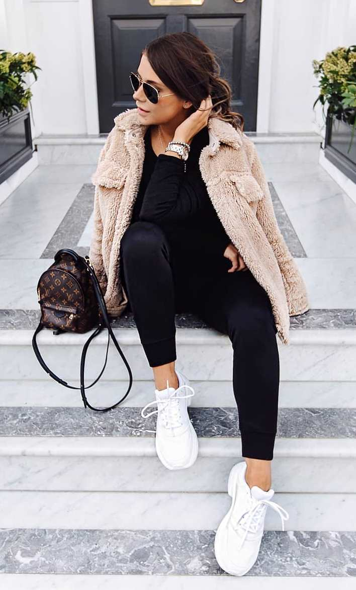 trendy fall outfit idea with sneakers : backpack + beige jacket + black pants + top