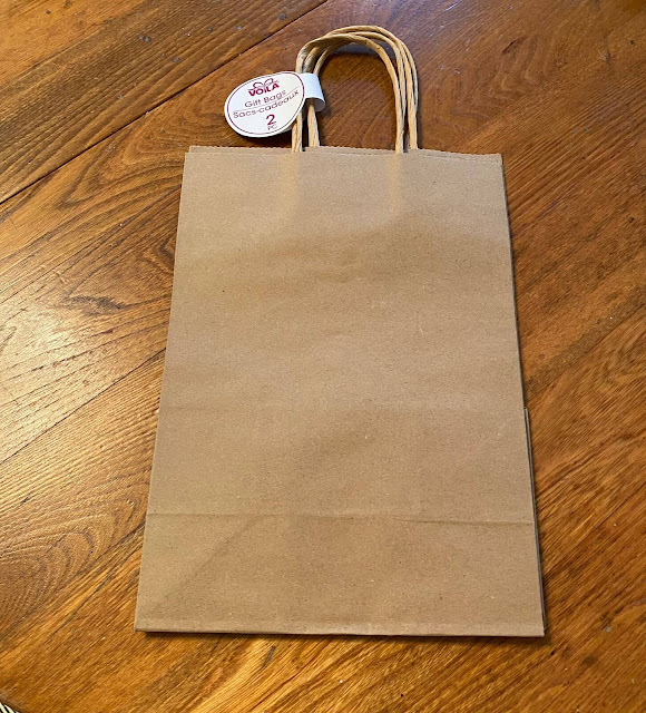 Photo of two plain brown paper gift bags