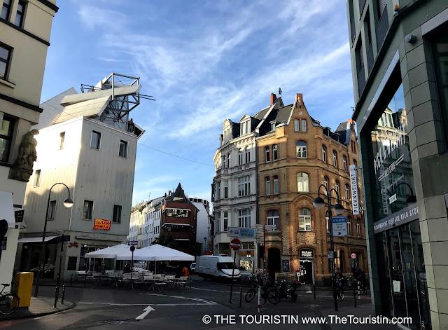 Street scene with four properties on each street corner.