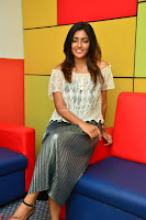 Eesha in a cute deep neck top and Skirt at at Big FM 026.JPG