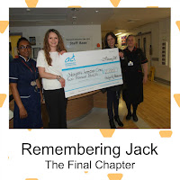 Nurses and staff gathered to receive charity cheque ant Cambridge Hospital