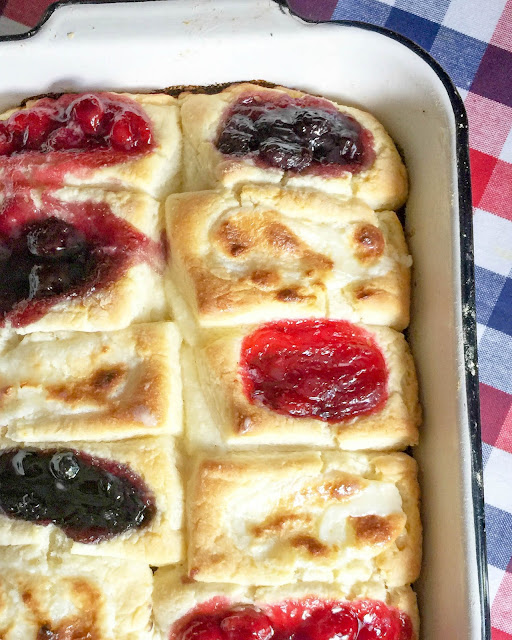 Tender, sweet biscuit dough with a well in the center filled with blackberry or strawberry jam, blueberry or cherry pie filling,  or a mixture of sweetened cream cheese