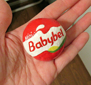 Babybel cheese painted rock by Ana Garcia