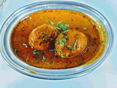 Serving Dhaba style egg curry