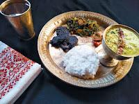 platter: Matidail (black gram) ,dhekia xaak bhaji (fiddlehead ferns),  bhedailotar bor (skunk vine fritters) and ou tenga achar.
