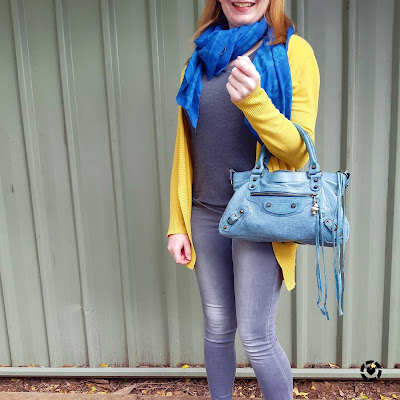 awayfromblue Instagram mustard cardigan and teal and turquoise skull scarf and Balenciaga first bag