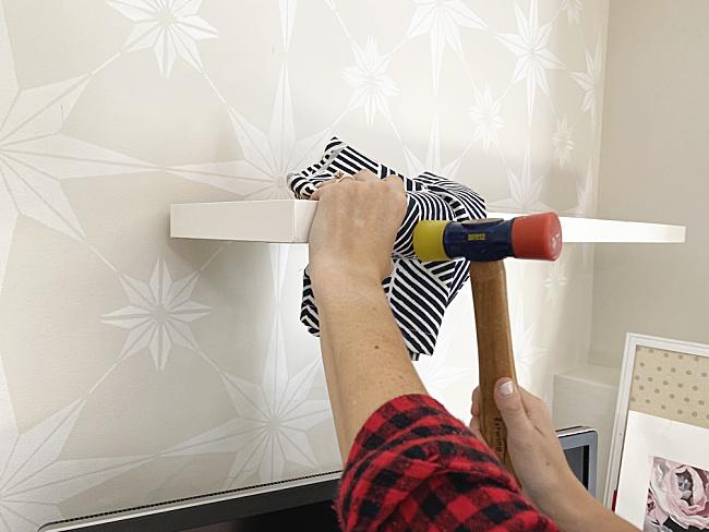 rubber mallet banging shelf onto bracket