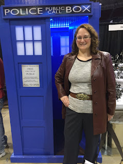 Photo of me in Donna Noble cosplay in front of a TARDIS.