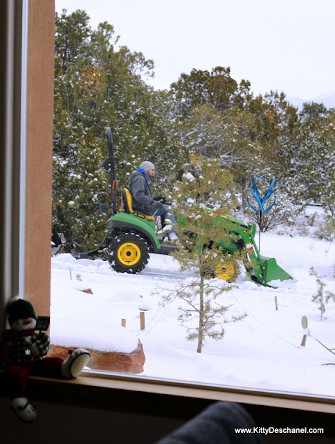 plowing the snow on a john deere tractor