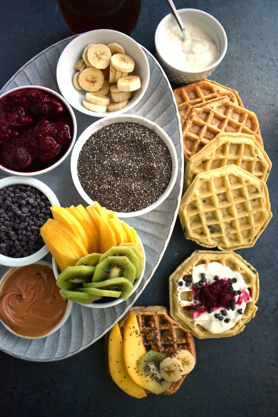Make Your Own Waffle Bar features tons of fun toppings including fresh fruit, nuts, yogurt, raspberry sauce, maple syrup, peanut butter, chocolate chips and more! www.nutritionistreviews.com
