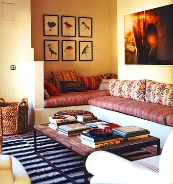 Built in sofas with stripes and mixed prints in Amanda Peet house in Vogue