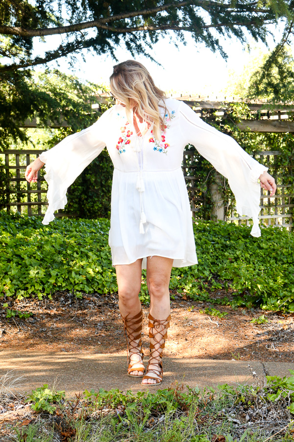parlor girl long sleeve dress with tassels