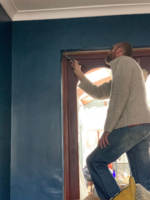 man decorating with paint