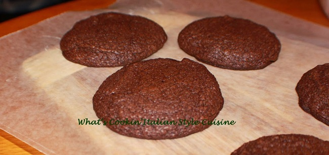 baked chocolate cookies on parchment paper