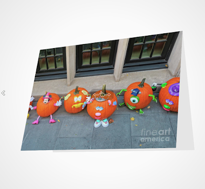 "This image is a screen-shot of one of my Halloween-themed notecards which is titled ""The Pumpkin Choir."" The picture was taken on the Eastside of NYC in front of a brownstone which was decorated for when for Halloween. It shows an array of pumpkins that have faces painting on them they could be carolers if the season had been Christmas. A copy of this image is featured in volume two of my book series, ""Words In Our Beak."" Info re this series can be found on my blog @ https://www.thelastleafgardener.com/2018/10/one-sheet-book-series-info.html AND info re this particular note-card is can be found on Fine Art America @ https://fineartamerica.com/featured/the-pumpkin-choir-patricia-youngquist.html?product=greeting-card"