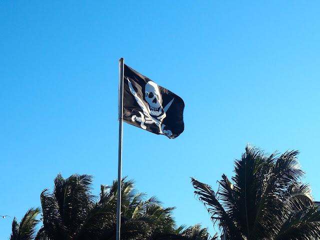 Jolly Roger pirate flag flying on Playa del Carmen beach, Mexico