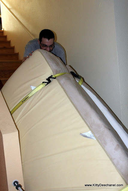 pushing the mattress down the stairs