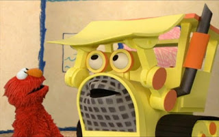 The Bulldozer shows Elmo how it works. Sesame Street Elmo's World Building Things Interview